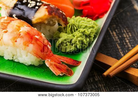 The Composition Of Nigiri Sushi With  Shrimp, Eel, Salmon, Butterfish On Rice