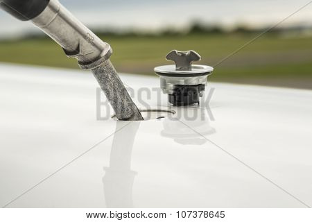Fuel Nozzle Filling Up Aircraft
