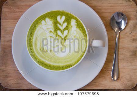 Close up hot Greentea matcha latte wood background