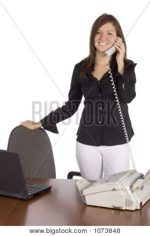 Standing Businesswoman On The Phone