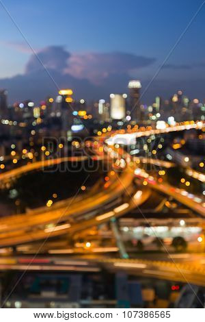 Abstract blurred of highway interchanged with city lights background
