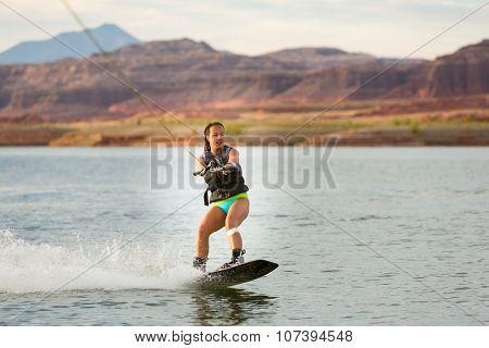 Girl Wakeboarding In Desert Sunshine