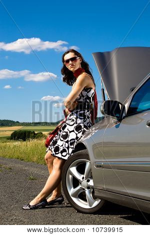 Woman By Broken Down Car