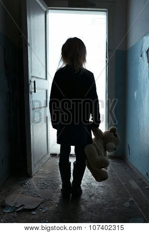 Depressed girl leaving the room
