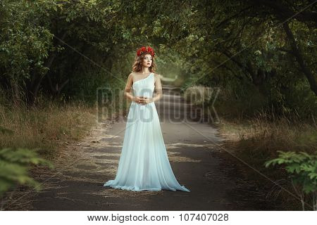 Fairy Girl Standing On The Road In Woods.