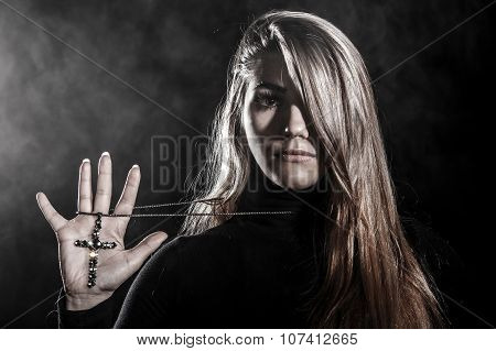 Woman Holding A Cross On Her Palm