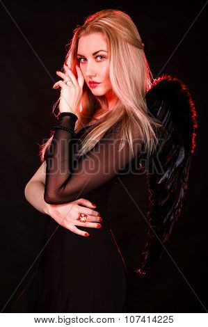 Beautiful Young Woman With Black Wings