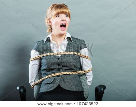 Afraid Kidnapped Woman Tied With Rope To Chair.