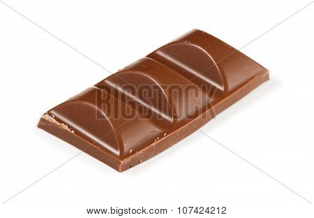 Three blocks of milk chocolate on white