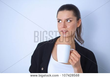 Young woman holding a mug, isolated on white background