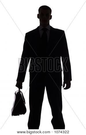 Silhouette Of Man With Suitcase