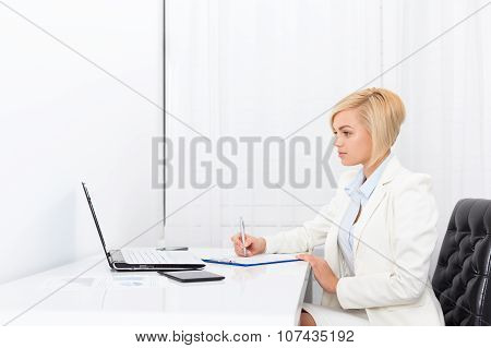 businesswoman writing contract, signing document