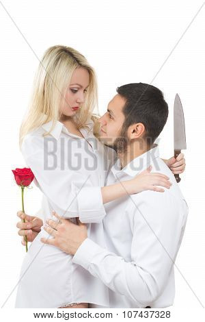 girl holding knife traitor. man with rose in his hand. white background