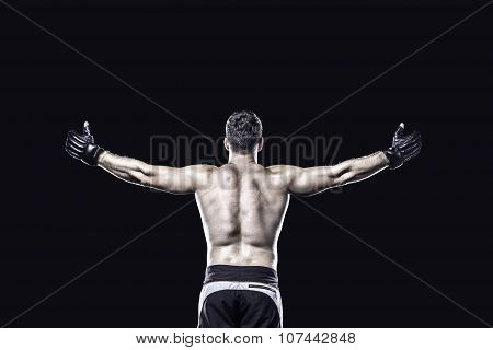 MMA fighter in celebrating victory, behind view, isolated