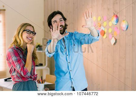 Creative team envisioning their ideas in casual office