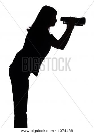 Silhouette Of Woman With Binoculars