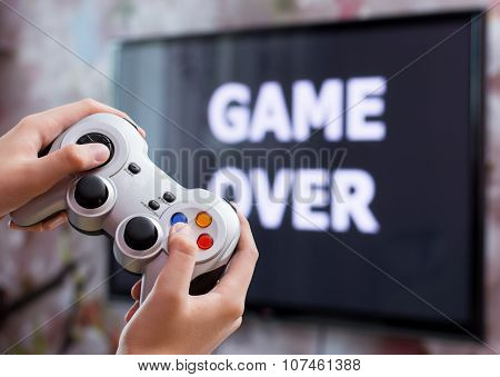 Playing video game with controller in hands
