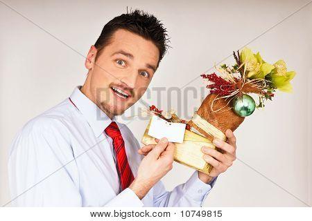 Young man shows Christmas gift
