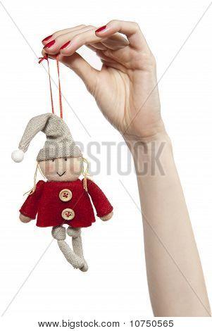 Female Hand Holding A Dwarf
