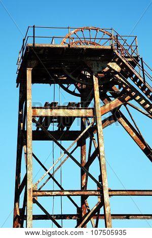 Hoist wheel used at a coal mine shaft poster