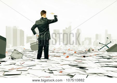 Businessman Is Looking At The Horizont Among Pile Of Papers And Office Stuff