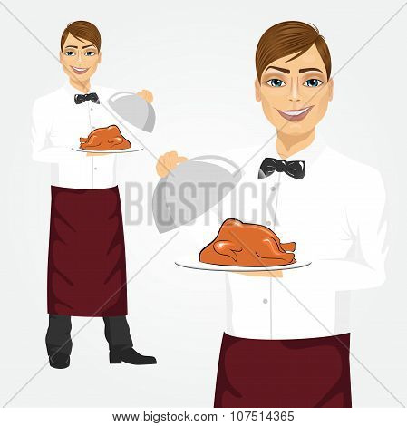 Portrait of young handsome waiter with tray serving roasted poultry poster