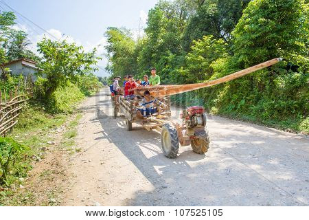 unidentified man driving tractor on a rural road
