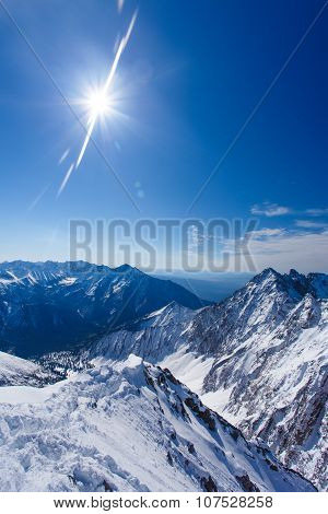 Winter landscape of mountains. Snow-covered mountains. Beautiful mountain landscape. Aerial view of snow mountain. Snow hills landscape. Mountain tops in snow.