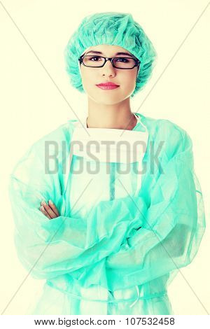 Portrait of happy young woman doctor or nurse with surgical mask and cap