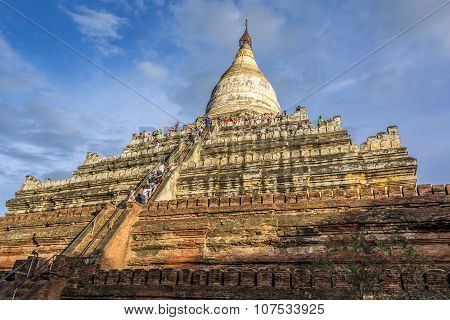 People Climb Up The Shwesandawa Pagoda In Pagan