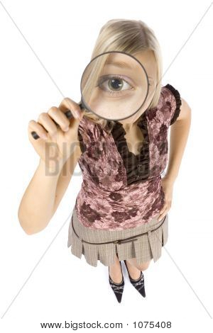 Headshot Of Young Blonde Woman With Magnifying Glass