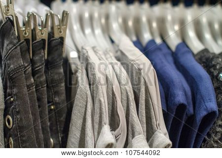 Jeans And T-shirts Hanging On A Hanger In The Store