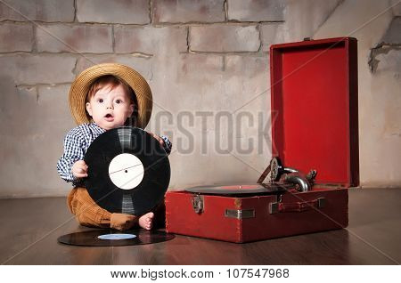 Funny Baby Boy In Retro Hat With Vinyl Record And Gramophone