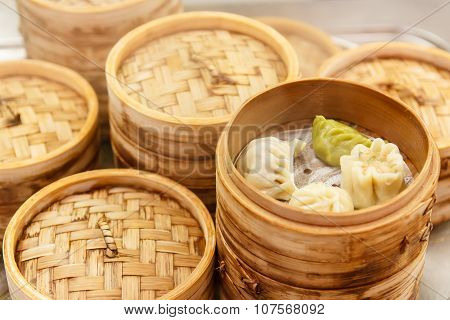 Chinese dumplings with meat and cabbage steamed with bamboo steamer poster