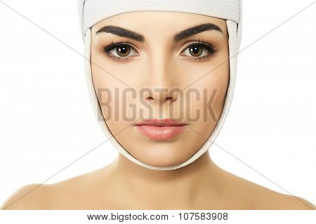 Young beautiful woman with an elastic bandage on her head, isolated on white poster