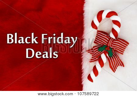 Black Friday Deals Red Plush background and a Candy Cane with text Black Friday Deals poster
