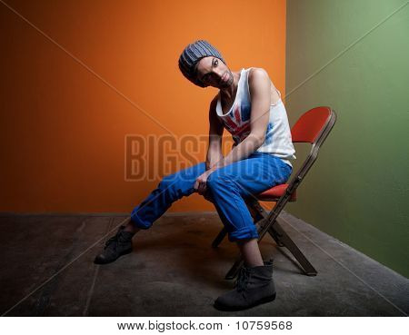 Cute Guy Sits In Chair