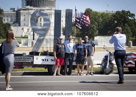 WASHINGTON DC - SEPT 11, 2015: U.S. Congressman Dave Brat (R-Va.) by the 911 Standing Tall Memorial sculpture by SteelCrazy IronArt in front of the U.S. Capitol at 2 Million Bikers to DC honor ride.