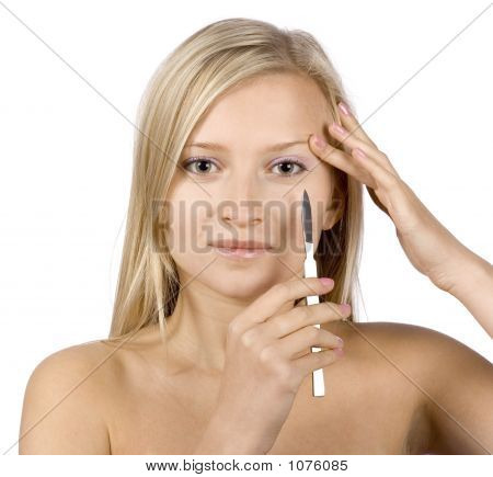 Face Of Young Blonde Woman + Scalpel In Her Hand