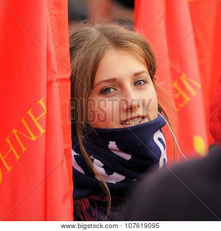 Orel, Russia - November 7, 2015: Communist Party Meeting. Communist Girl With Red Flags. Smiling Gir