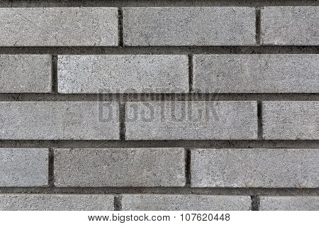 Grey brick wall background closeup