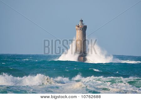 """Lighthouse called """"Le phare du four"""" in Tremazan in Brittany France during storm in November poster"""
