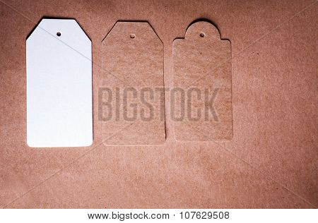 Three paper lable of different shape on craft paper background