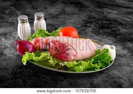 Fresh Raw Pork Hindleg Foot Decorated With Vegetables And Clipping Path