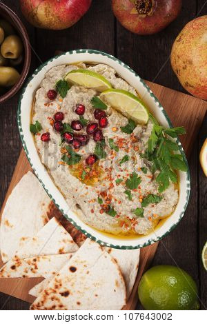 Baba ghanoush, levantine eggplant dip with slices of pita bread
