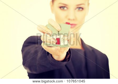 Aggresive businesswoman crushing small house. poster