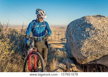 senior male with a mountain bike in Colorado foothills, Soapstone Prairie Natural Area near Fort Collins