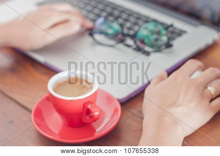 Red Coffee Cup On Work Station