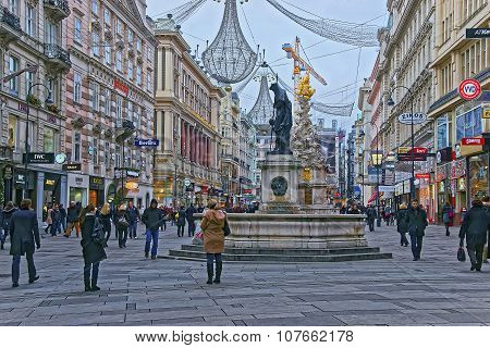 Holy Trinity Column And Graben Street In The Old City Of Vienna In Austria With Christmas Decoration