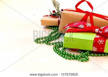 Boxes With Gifts Decorated With Ribbons On A White Wooden Background